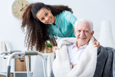 caregiver Smiling doctor caring about patient at home